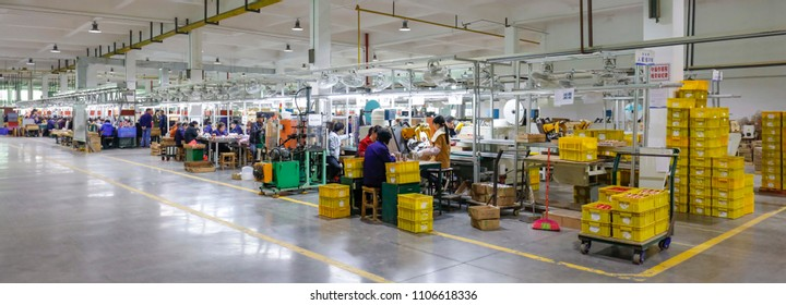JIANGXI CHINA-March 30, 2018: workers operate machines in the workshop production line to produce electronic accessories. A sweaty electronics factory in Jiujiang, East China's Jiangxi province.