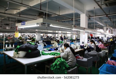 JIANGXI CHINA-Nov 26, 2012, Yangtze River Industrial Park, Vico printing  dyeing Knitting Co. Ltd. production workshop, workers are sewing processing apparel products exported to Europe and america.