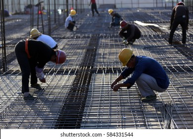 JIANGXI CHINA-October 14, 2013: Jiangxi, East China's Jiujiang, migrant workers (migrant workers) in the construction of plant. 2015, China's migrant workers group of about 277 million people.