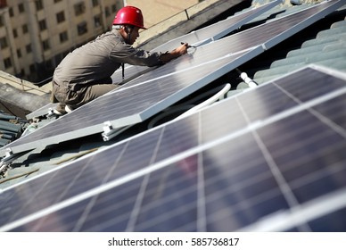 """JIANGXI CHINA-Sep18, 2013:Jiujiang, East China, the power plant installed on the roof of the residents of photovoltaic power generation equipment. """"Home power station"""" to meet the life of electricity."""