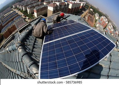 "JIANGXI CHINA-Sep18, 2013:Jiujiang, East China, the power plant installed on the roof of the residents of photovoltaic power generation equipment. ""Home power station"" to meet the life of electricity."