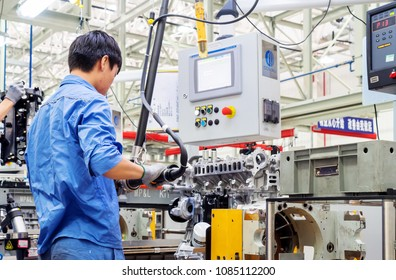 JIANGXI CHINA-September 1, 2017, Jiangxi Nanchang Jiangling Motor Group Company, the workers are assembling cars. Factory Avtotor Car.Car factory Avtotor.Workers assembled in China made cars.