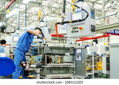 JIANGXI CHINA-September 1, 2017, Jiangxi Nanchang Jiangling Motor Group Company, the workers are assembling cars. Factory Avtotor Car.Car factory Avtotor.Workers assembled in China made cars.