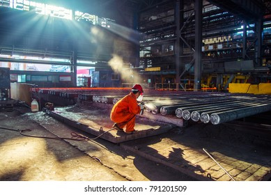 Jiangyin, Jiangsu/China - September 12, 2017: The workers are marking the batch number for steel in the iron and steel plant.