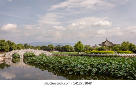 Jianshui, Yunnan, China - August 17, 2018: Garden with lotus in the pond in the Confucian Temple (Wenmiao), Jianshui, Yunnan, China. One of the biggest and oldest Confucian temples. National heritage.