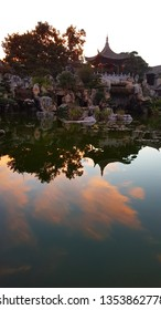 Jianshui, Yunnan, China - November, 2018. Sunset clouds reflecting in the lake. Zhu's Family Garden in the typical Chinese noble residence of the Zhu's Family