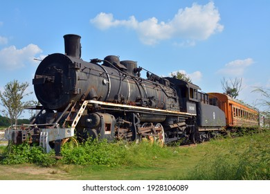 Jiaxing,China. september 30th 2020.  An old an abandoned steam train by the side of the road on the outskirts of the city.
