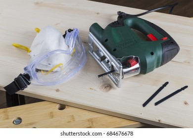 Jig saw with goggles and mask