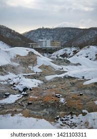 Jigokudani hell valley and distant hotels in Noboribetsu