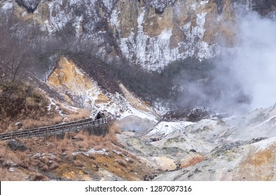 Jigokudani (Hell Valley), the famous attraction at Noboribetsu Hokkaido Japan. The valley just above the town of Noboribetsu, displays hot steam vents, sulfurous streams and other volcanic activity.
