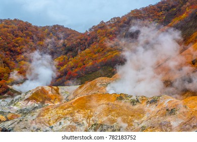 Jigokudani hell valley in hokkaido, Japan. Hell valley in japanese is 'noboribetsu'. It is one of the famous tourist destination to visit. White heavy sulfur gas steaming from the ground smell bad.