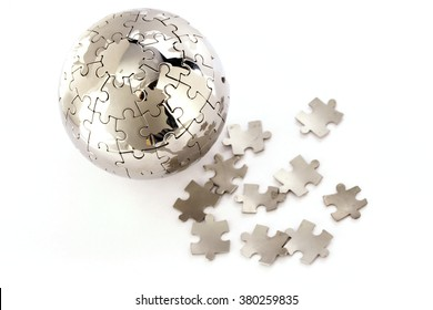 Jigsaw globe puzzle and pieces on white background