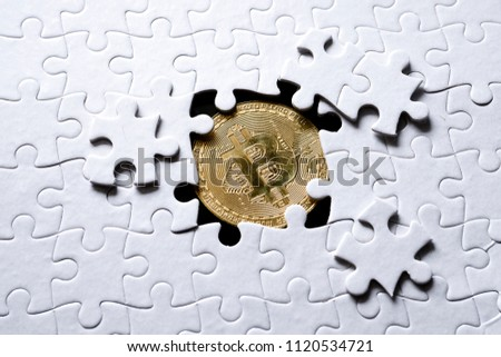 Jigsaw pattern with bitcoin underneath