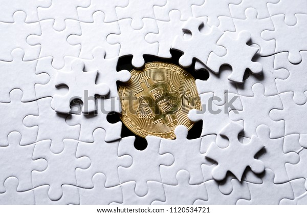 Jigsaw pattern with bitcoin underneath