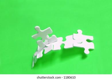 Jigsaw piece man crossing jigsaw bridge with bright background
