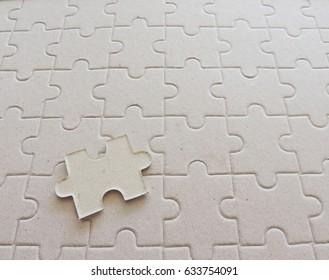 jigsaw pieces with copy space on jigsaw background.