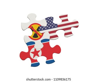 Jigsaw pieces depicting the denuclearisation issue between USA and North Korea isolated on white background