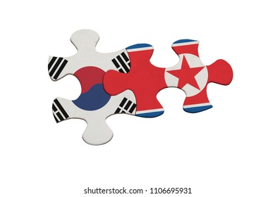 Jigsaw pieces representing the relationship between North Korea and South Korea isolated on white background