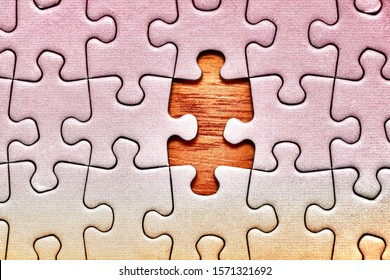 Jigsaw puzzle background, one last piece missing only, almost complete
