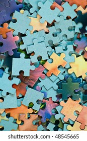 Jigsaw puzzle. Background from parts of puzzle. Pile of color mosaics
