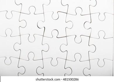 Jigsaw puzzle with blank white pieces