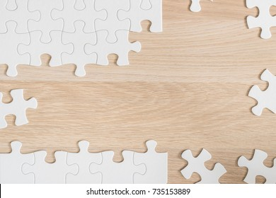Jigsaw puzzle game piece on light cream brown wood table background for business startup solution and analytical problem solving concept