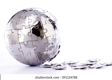 Jigsaw puzzle globe on white background