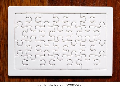 Jigsaw puzzle on wood background