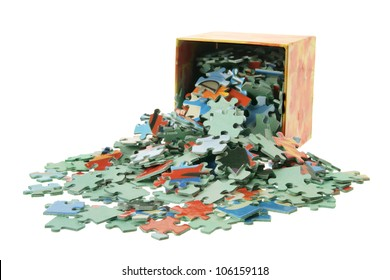 Jigsaw Puzzle Pieces and Box on White Background