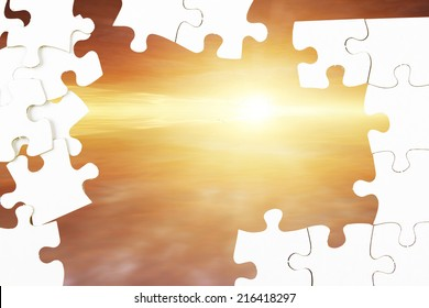 Jigsaw puzzle pieces in front of sky