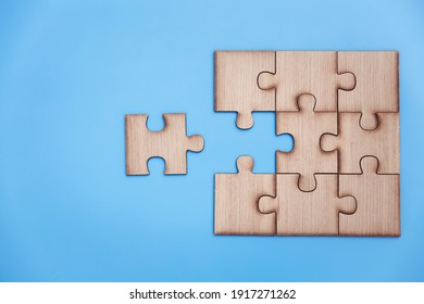 jigsaw puzzle pieces on blue background,  Business solutions, success and strategy, Business partnership concept. Copy space.