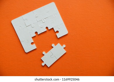 Jigsaw puzzle pieces on orange background,Business success concept.