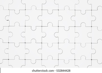 Jigsaw puzzle pieces pattern on paper, background texture. Concept for business or job finish the successfully