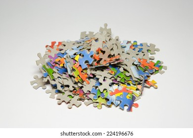 Jigsaw puzzle pieces in a pile, close-up