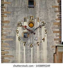 JIHLAVA / CZECH REPUBLIC - MAY 28th, 2012: Ancient clock on Saint Jacob's Church (Kostel sv. Jakuba). Rusty fingers and numbers on old wall. Window with pigeons on the clock face. Time on clock: 10h10
