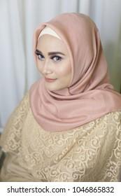 jilbab using asian woman beautiful make up. smiling young woman wearing makeup and hijab.