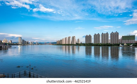 Jilin, China - June 25, 2016: The high modern buildings in Jilin can see from another side of Songhua River. Jilin is city in the northeast of China .It is the old capital city of Jilin province.