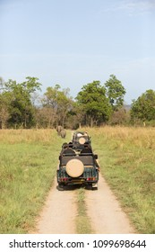 JIM CORBETT, INDIA-May 08: Tourists on a Safari jeep watching Asian elephants in the grassland of Dhikala on May 08, 2018 in Jim Corbett, Uttrakhand, India