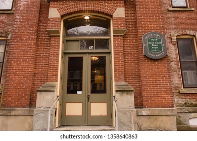Jim Thorp, PA / USA - March 30, 2019: Mauch Chunk Public School in Jim Thorp And Three Towers Apartments.