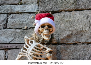 Jim Thorpe, PA - 22 December 2019: Skeleton decorated for the holidays outside a store in downtown Jim Thorpe.
