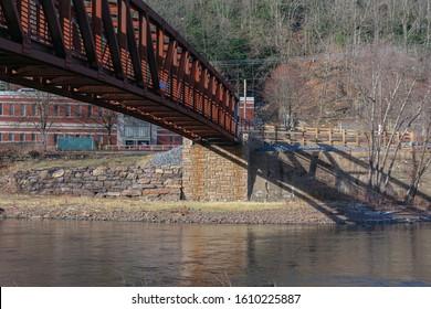 Jim Thorpe, PA - 24 December 2019: Walking bridge over the Lehigh River connecting both sides of Jim Thorpe, PA