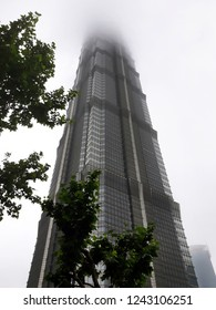 Jin Mao Tower disappearing in fog. Shanghai, May 2018.