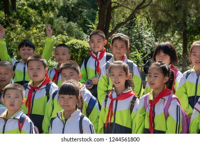 Jinan, Shaanxi Province, China, September 30, 2018, Chinese school children in uniform in 1000 Buddha mountain park