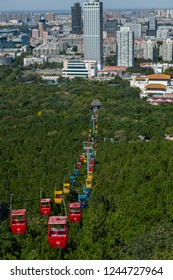 Jinan, Shandong Province, China, Sept 30, 2018, Gondola in thousand buddha mountain park with Jinan in background
