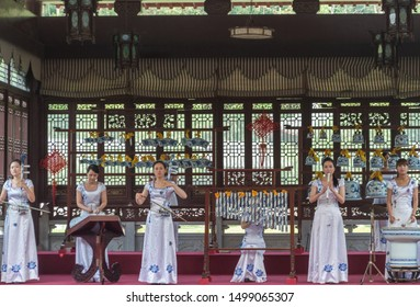 "Jingdezhen, Jiangxi province / China - May 29, 2014: Female music ensemble performing traditional Chinese music on porcelain instruments. Jingdezhen is considered a ""Porcelain Capital"" of the world"
