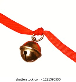 Jingle bell red ribbon on white background