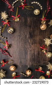 jingle Bells and  decorations on dark wooden, christmas background