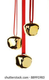 jingle bells hanging on red ribbon, isolated on white