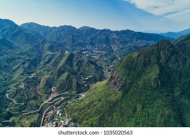 Jinguashi Aerial View - Famous travel destinations of Taiwan, panoramic bird's eye view with morning blue bright sky, shot in Ruifang District, New Taipei City, Taiwan.