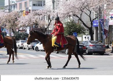 Jinhae, South Korea - April  2017 Man playing as Admiral Yi Sun Shin riding a horse during Jinhae Naval Festival Parade